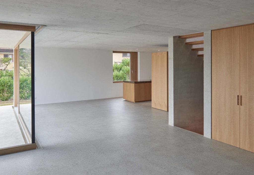 Villas contemporaines en béton vue intérieure rez