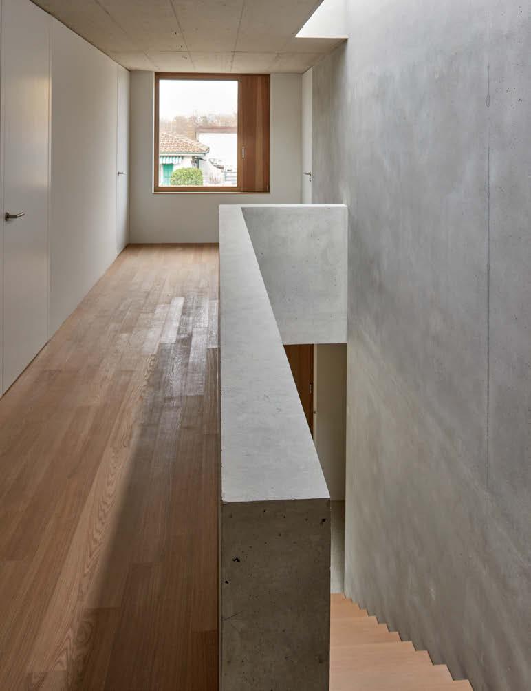 Villa contemporaine en béton vue escalier mur béton